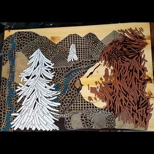 Bear drawing done in wood with ink.